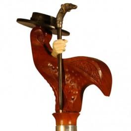 'Cordobés' de ébano, puño de madera de coral y bastoncito de ébano con perro de plata .
